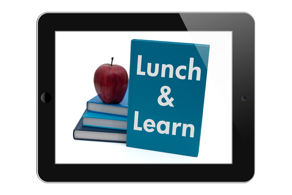 Scheduling a Lunch and Learn, Tablet with text Lunch and Learn isolated on a white background